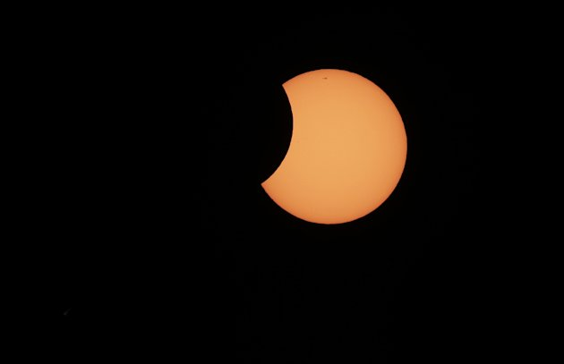 The moon begins to cross in front of the sun during a partial solar eclipse in Sydney, Friday, May 10, 2013. At remote outposts across Australia, scientists and spectators gathered to watch as the ecl