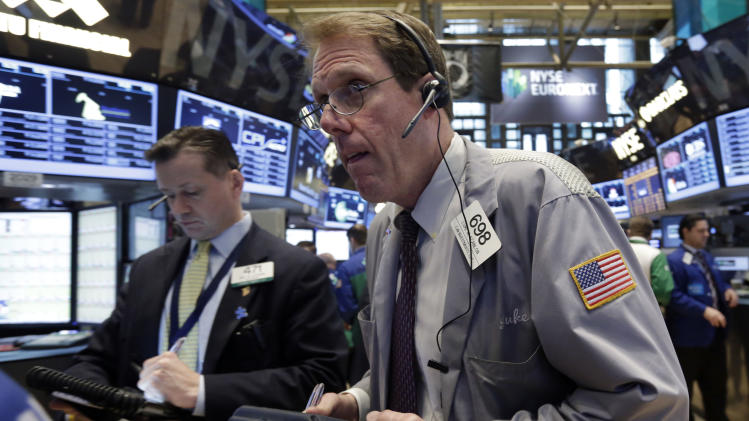 Trader Luke Scanlon, right, works on the floor of the New York Stock Exchange Thursday, April 11, 2013.  Stock indexes are little changed in early trading on Wall Street after three days of gains. (AP Photo/Richard Drew)