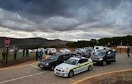 A funeral hearse and police convoy arrive at Mvezo resort to collect the remains of former South African president Nelson Mandela's children on July 3, 2013