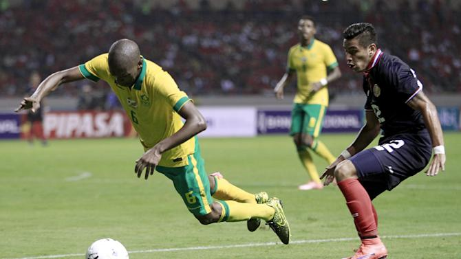 South Africa's Ngcongca is fouled by Costa Rica's Matarrita during their international friendly soccer match at the National stadium in San Jose, Costa Rica