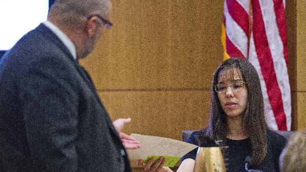 Jodi Arias, right,  is questioned Monday March 4, 2013, during redirect from defense attorney Kirk Nurmi,left,,  in Maricopa County Superior Court in downtown Phoenix.  Arias is on trial for the murder of Travis Alexander in 2008.  (AP Photo/The Arizona Republic, Tom Tingle, POOL)