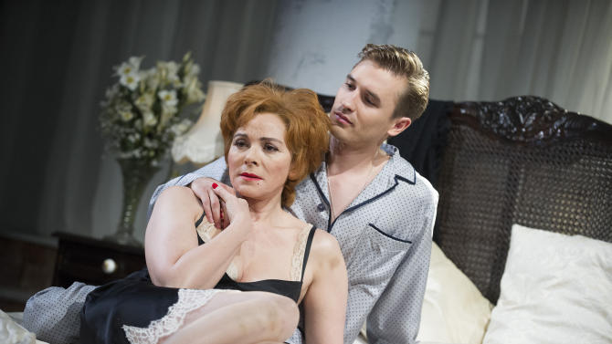 "In this undated photo released by The Od Vic theatre, actress Kim Cattrall, and actor Seth Numrich, during a scene from the production of ' Sweet Bird Of Youth' by Tennessee Williams. There's little doubt Cattrall could have coasted comfortably after creating one of the most indelible TV characters in years as the vampish Samantha Jones in ""Sex and the City."" Since the show ended in 2004, the 56-year-old has done two ""Sex and the City"" movies, but has also taken stage roles in London and New York in the likes of ""Private Lives"" and ""Antony and Cleopatra."" Still, it took some persuading by Old Vic artistic director Kevin Spacey to get her to agree to play the physically humbling, emotionally demanding role of Alexandra Del Lago, a drug-addled falling star on the run from a disastrous comeback attempt who finds herself holed up in a Gulf Coast hotel room with tarnished local golden boy Chance Wayne. (AP Photo/Tristram Kenton, Old Vic) EDITORIAL USE ONLY"