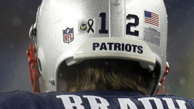 FILE - Wearing a sticker on his helmet to honor the victims of the Sandy Hook Elementary School shootings, New England Patriots quarterback Tom Brady takes to the field before an NFL football game against the San Francisco 49ers in Foxborough, Mass. on Sunday, Dec. 16, 2012. The NFL's New England Patriots and the New England Revolution of Major League Soccer are the only American big league franchises with names evoking a group of states. (AP Photo/Elise Amendola, File)