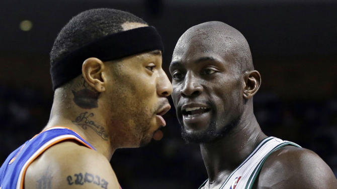 Boston Celtics center Kevin Garnett, right, has words with New York Knicks' Kenyon Martin during the first half in Game 4 of a first-round NBA basketball playoff series in Boston, Sunday, April 28, 2013. (AP Photo/Elise Amendola)