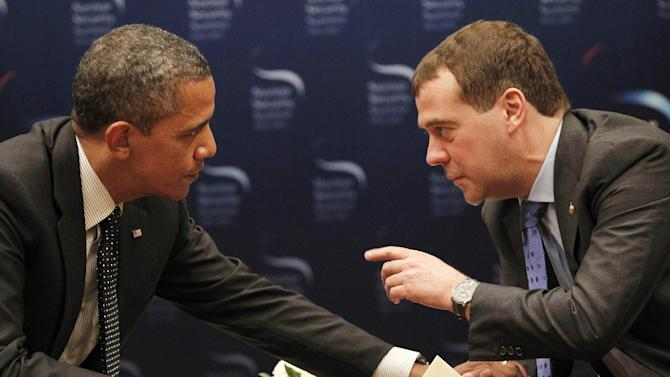 FILE -In this March 26, 2012 file photo, President Barack Obama talks with Russian President Dmitry Medvedev in Seoul, South Korea. President Barack Obama will play host this weekend to an extraordinary confluence of international summitry, with world leaders scuttling from the Maryland mountains to downtown Chicago as they grapple for fixes to Europe's mounting economic woes and solidify plans for winding down the decade-long war in Afghanistan.  (AP Photo/Pablo Martinez Monsivais, File)