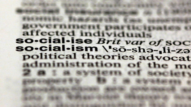 The word socialism, from the 11th edition of Merriam-Webster's Collegiate Dictionary, is shown in this photograph, in New York,  Wednesday, Dec. 5, 2012.  Thanks to the election, socialism and capitalism are forever wed as Merriam-Webster's most looked-up words of 2012. (AP Photo/Richard Drew)