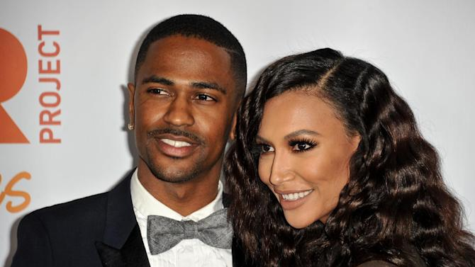 """FILE - In this Dec. 8, 2013 file photo, Big Sean, left, and Naya Rivera arrive at TrevorLIVE Los Angeles Benefit at the Hollywood Palladium, in Los Angeles. The rapper and actress are no longer engaged. A spokeswoman for Big Sean announced Wednesday, April 9, 2014, that he has canceled plans to marry the """"Glee"""" star. (Photo by Richard Shotwell/Invision/AP, file)"""