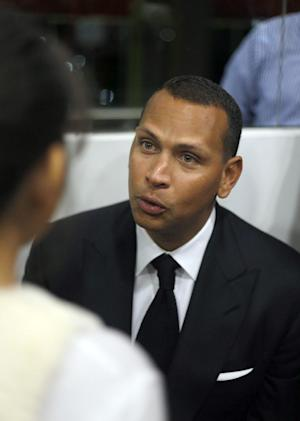 Alex Rodriguez speaks during a news conference at his gym in Cancun, Mexico, Thursday, Jan. 16, 2014. Alex Rodriguez says his season-long suspension could be a benefit, allowing him to rest and return to the Yankees for the final three years of his contract. Rodriguez was suspended for violating baseball's drug agreement and labor contract. (AP/Israel Leal)
