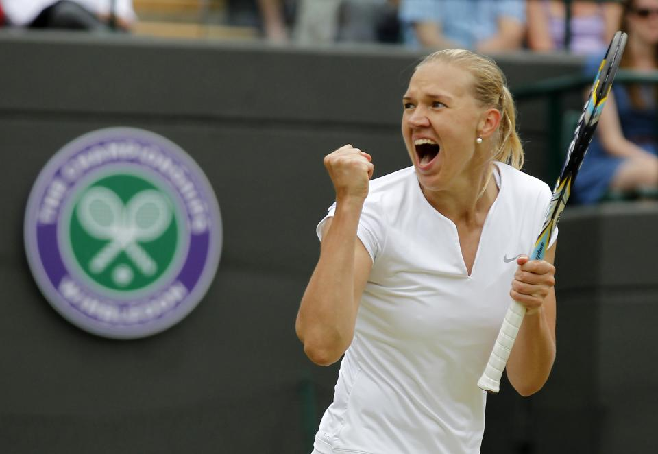 Kaia Kanepi of Estonia celebrates after beating Laura Robson of Britain during a Women's singles match at the All England Lawn Tennis Championships in Wimbledon, London, Monday, July 1, 2013. (AP Photo/Sang Tan)