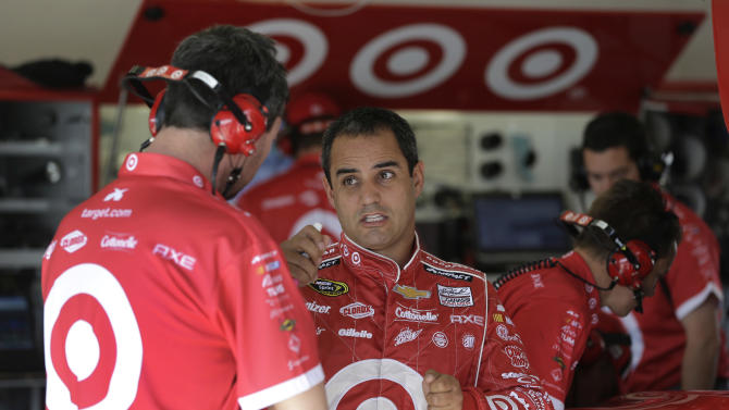Juan Pablo Montoya, of Colombia, talks with crew members in his garage during the final practice for the NASCAR Daytona 500 Sprint Cup Series auto race at Daytona International Speedway, Saturday, Feb. 23, 2013, in Daytona Beach, Fla. (AP Photo/John Raoux)
