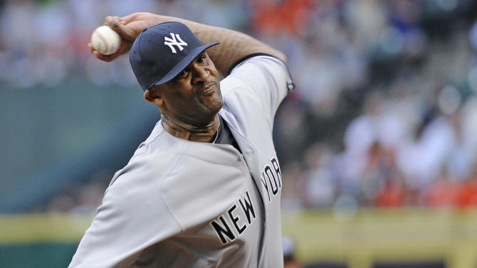 FILE - In this Tuesday, April 1, 2014 file photo, New York Yankees' CC Sabathia delivers a pitch against the Houston Astros in the first inning of a baseball game on opening day in Houston. Any hopes the New York Yankees had of CC Sabathia returning to their ravaged rotation this year are over. General manager Brian Cashman says Sabathia will have season-ending surgery on his right knee Wednesday, July 23, 2014. Cashman says indications are the left-hander will be ready for spring training next year, but there are no guarantees (AP Photo/Pat Sullivan, File)