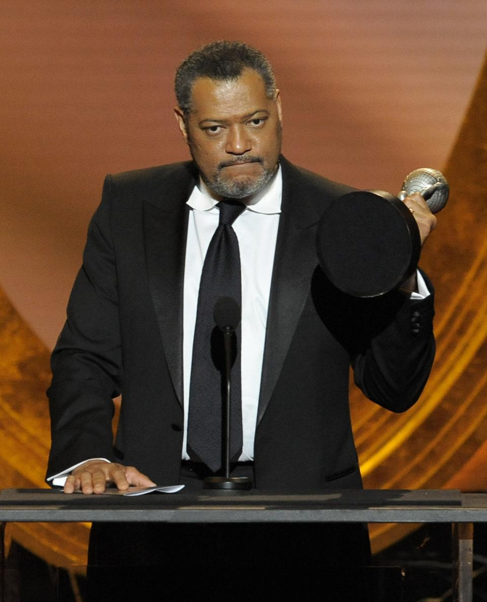 "Laurence Fishburne accepts the award for outstanding actor in a television movie, mini-series or dramatic special  for ""Thurgood"" at the 43rd NAACP Image Awards on Friday, Feb. 17, 2012, in Los Angeles. (AP Photo/Chris Pizzello)"