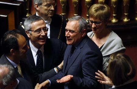 Piero Grasso (C) is congratulated after the vote electing him as the new Senate president at the Senate in Rome March 16, 2013. REUTERS/Remo Casilli