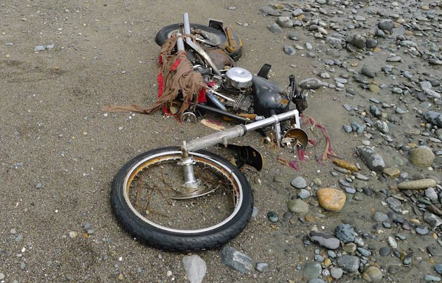 In this photo taken by Canadian Peter Mark in the end of April, 2012, and released on Wednesday, May 2, a Harley-Davidson motorbike lies on a beach in Graham Island, western Canada. Japanese media say