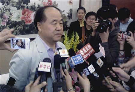 Chinese writer Mo Yan (L) talks to the media during a news conference in his hometown Gaomi, Shandong province October 11, 2012. REUTERS/China Daily