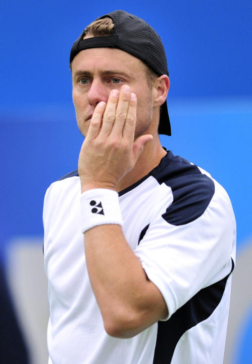 Lleyton Hewitt Of Australia Reacts  AFP/Getty Images