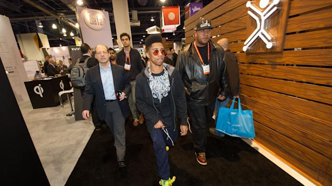"Hip hop artist, ""Lil Twist"" arrives to International CES 2013, on Thursday, January 10, 2013 in Las Vegas, NV for the debut of his new headphone collection ""Twist Swag Headphones by Nikura USA (Photo by Al Powers of Powers Imagery/Invision for Nikura USA/AP Images)"
