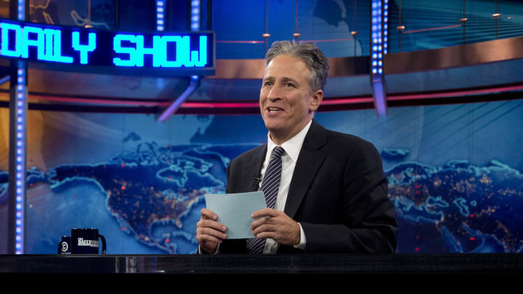 "FILE - This Oct. 18, 2012 file photo shows host Jon Stewart during a taping of ""The Daily Show with John Stewart"", in New York. Comedy Central says Jon Stewart will take a break from ""The Daily Show"" starting in June to direct and produce his first feature film. Stewart will be directing and producing ""Rosewater"" from his own script based on a memoir by Maziar Bahari. This Iranian journalist was falsely accused of being a spy and imprisoned by the Iranian government in 2009 while covering Iran's presidential election. (AP Photo/Carolyn Kaster, file)"