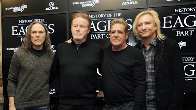 """FILE - This Jan. 19, 2013 file photo shows members of The Eagles, from left, Timothy B. Schmit, Don Henley, Glenn Frey and Joe Walsh after a news conference for their documentary film """"The History of The Eagles""""  at the 2013 Sundance Film Festival in Park City, Utah. The documentary film will air in two parts on Showtime on Friday and Saturday, Feb. 15 - 16.  (Photo by Chris Pizzello/Invision/AP, file)"""