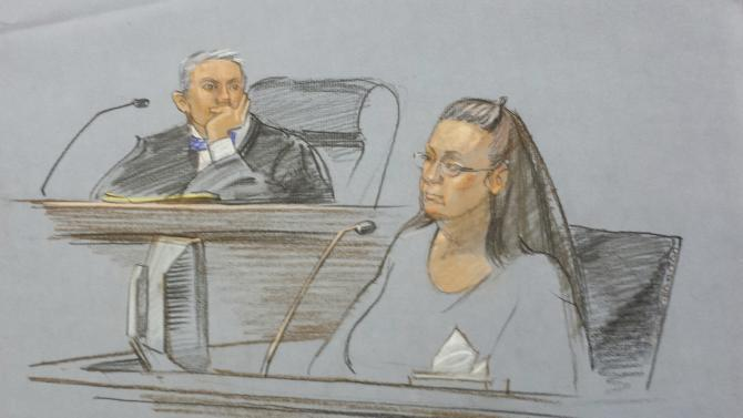 Rowan County clerk Davis is shown in this courtroom sketch during her contempt of court hearing for her refusal to issue marriage certificates to same-sex couples, at the United States District Court in Ashland
