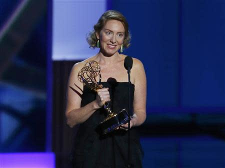 "Sarah Bromell accepts the award for Outstanding Writing for a Drama Series for ""Homeland"" for her husband Henry Bromell, who died in March of this year, at the 65th Primetime Emmy Awards in Los Angeles"