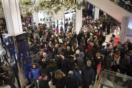 Shoppers enter Macy's to kick off Black Friday sales in New York
