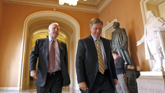 Sen. John McCain, R-Ariz., left, and Sen. Lindsey Graham, R-S.C., walk on Capitol Hill in Washington Tuesday, Dec. 14, 2010. (AP PhotoByline Withheld)
