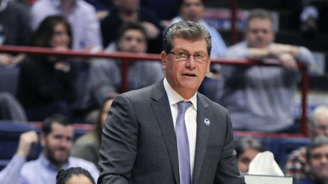 Connecticut head coach Geno Auriemma stands near the bench during the first half of a women's college basketball regional semifinal game against Texas in the NCAA Tournament on Saturday, March 28, 2015, in Albany, N.Y. (AP Photo/Tim Roske)