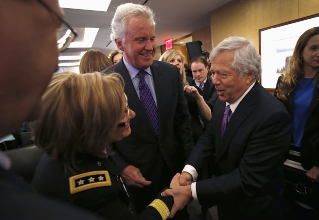 GE CEO Immelt and New England Patriots owner Kraft with Army Surgeon General Horoho at a news conference announcing the Head Health Initiative, in New York