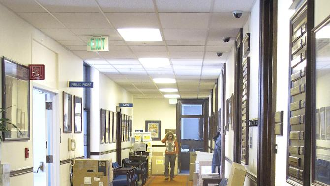 A trash can and boxes dot a corridor on the fourth floor of the state Capitol on Wednesday, April 18, 2012, in Juneau, Alaska. While the special session was just getting underway, offices were cleaning out following the regular session. (AP Photo/Becky Bohrer)