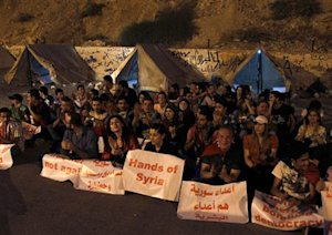 """Supporters of Assad take part in """"Over our Bodies""""…"""