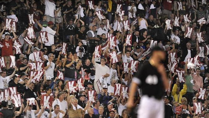 Chicago White Sox fans hold up K signs after Chicago White Sox starting pitcher Chris Sale struck out Toronto Blue Jays' Jose Bautista during the ninth inning of a baseball game Monday, July 6, 2015 in Chicago. Chicago won 4-2. (AP Photo/Paul Beaty)