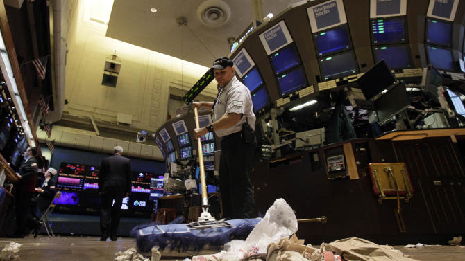 In this Friday, June 1, 2012, file photo, Raul Rodriguez sweeps the trading floor of the New York Stock Exchange. The global economy's foundations are weakening, one by one. The global economy's foundations are weakening, one by one. Already hobbled by Europe's debt crisis, the world now risks being hurt by slowdowns in its economic powerhouses. (AP Photo/Richard Drew, File)