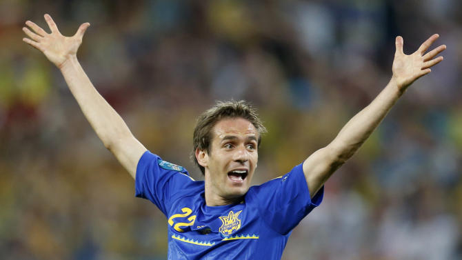 Ukraine's Marko Devic calls for referee's attention after firing a shot on goal during the Euro 2012 soccer championship Group D match between England and Ukraine in Donetsk, Ukraine, Tuesday, June 19, 2012. (AP Photo/Matthias Schrader)