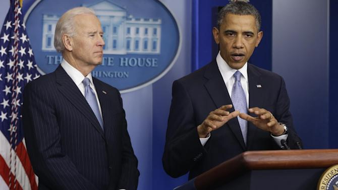President Barack Obama and Vice President Joe Biden make a statement regarding the passage of the fiscal cliff bill in the Brady Press Briefing Room at the White House in Washington, Tuesday, Jan. 1, 2013. (AP Photo/Charles Dharapak)