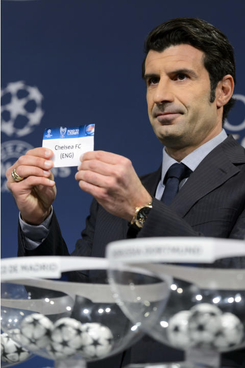 Former Portugal's soccer player and Champions League Lisbon final ambassador Luis Figo shows a ticket with British soccer team Chelsea FC during the draw of the round of 16 games of UEFA Champions