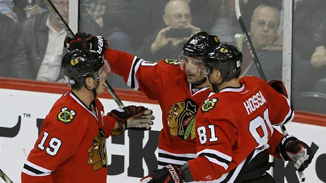 Sharp sparks Blackhawks to 5-1 win over Wild