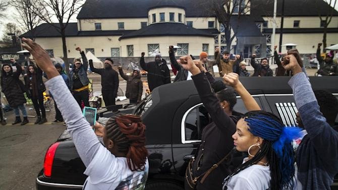 FILE - In a Wednesday, Nov. 25, 2015 file photo, family members of Jamar Clark get out of a limousine to show show support for the Black Lives Matter supporters as Clark's the funeral procession passed by the Minneapolis Police Department's 4th Precinct, in Minneapolis. Clark's death in a confrontation with police has sparked more than a week of protests. Activists have demanded not just answers in the investigation but public policy changes to address issues of economic injustice. (Richard Tsong-Taatarii/Star Tribune via AP, File)  MANDATORY CREDIT; ST. PAUL PIONEER PRESS OUT; MAGS OUT; TWIN CITIES LOCAL TELEVISION OUT