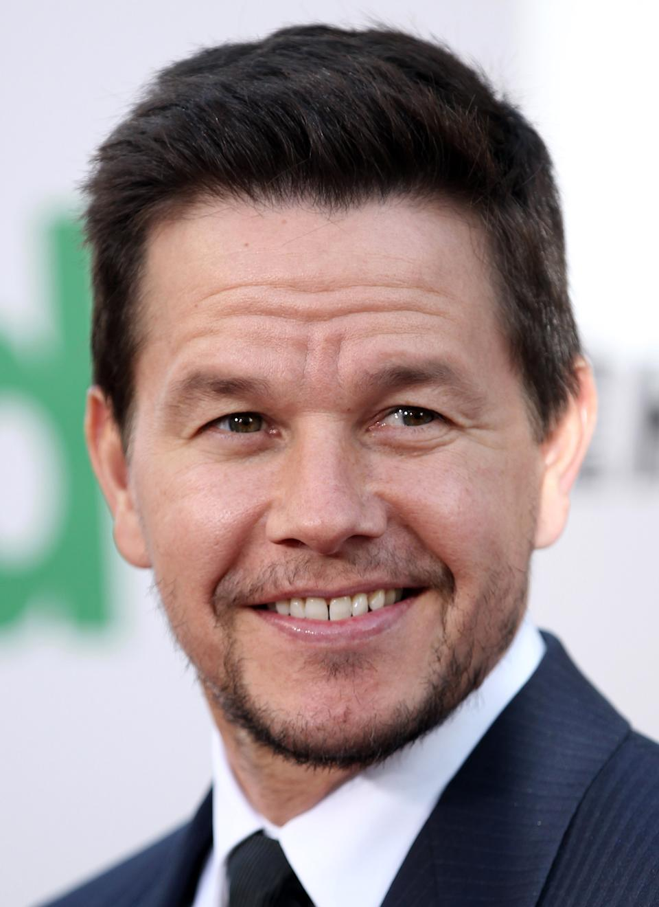"FILE - In this June 21, 2012 file photo, cast member Mark Wahlberg arrives at the premiere for ""Ted,"" in Los Angeles. ""Transformers"" director Michael Bay says the 41-year-old actor, Wahlberg, will star in the upcoming fourth ""Transformers"" film. (Photo by Matt Sayles/Invision/AP, File)"