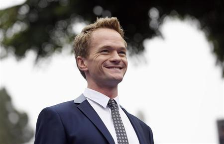 "Cast member Neil Patrick Harris poses at the premiere of the film ""The Smurfs 2"" at the Regency Village theatre in Los Angeles"