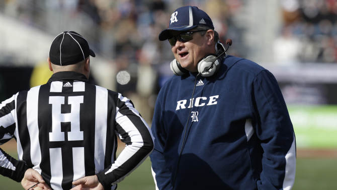 CORRECTS TO DAVID BAILIFF, INSTEAD OF TROY CALHOUN - Rice coach David Bailiff talks with head linesman Chad Green during the first half of the Armed Forces Bowl NCAA college football game against Air Force, Saturday, Dec. 29, 2012, in Fort Worth, Texas. (AP Photo/LM Otero)