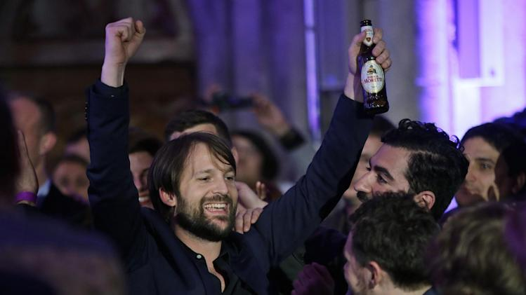 Danish chef Rene Redzepi celebrates after his restaurant Noma in Copenhagen, Denmark won the second place during the World's 50 Best Restaurant Awards in London, Monday, April 29, 2013. (AP Photo/Lefteris Pitarakis)