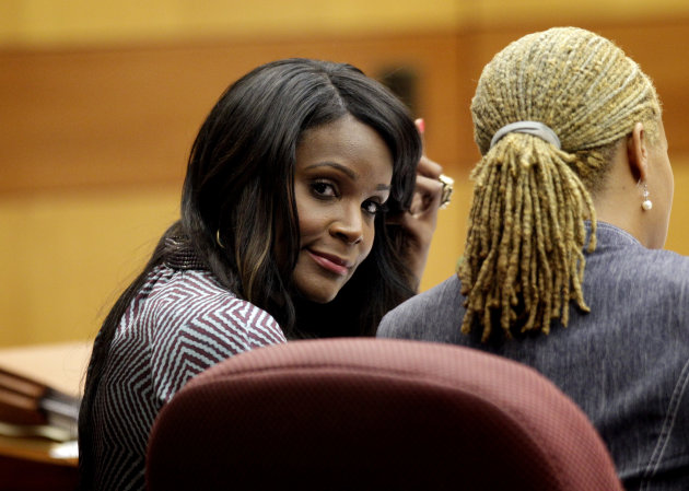 FILE - Tameka Foster Raymond, left, ex-wife of Hip-hop artist Usher Raymond, talks with her attorney Lisa West in court for a custody fight involving their two sons in this May 22, 2012 file photo taken in Atlanta. Willie A. Watkins funeral home in Atlanta confirmed Saturday July 21, 2012 it is handling funeral arrangements for 11-year-old Kirk Glover. He was the son of Usher's ex-wife Tameka Foster. The boy was run over July 6 by a personal watercraft on Lake Lanier, according to the Georgia Department of Natural Resources. (AP Photo/David Goldman, File)