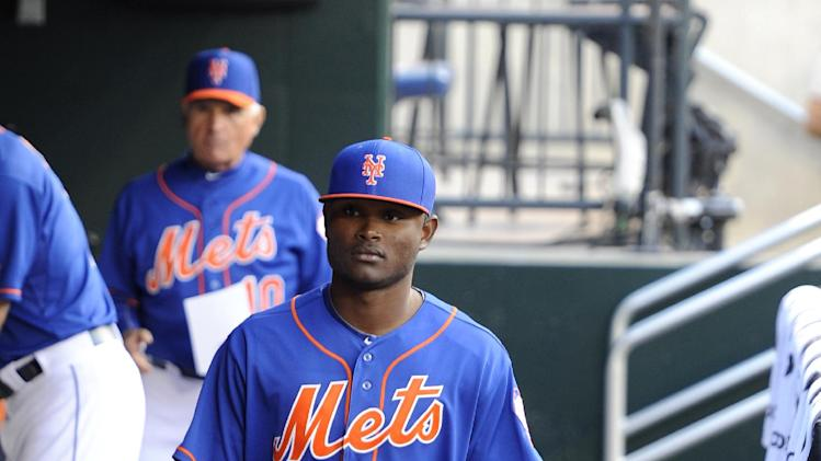 New York Mets Dilson Herrara walks through the dugout before the baseball game against the Philadelphia Philies at Citi Field on Friday, Aug. 29, 2014, in New York. Herrara is making his major league debut at second base tonight replacing the injured Daniel Murphy. (AP Photo/Kathy Kmonicek)