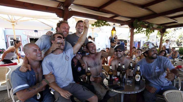 Dutch's salvage workers celebrates after the refloat operation maneuvers that allowed cruise liner Costa Concordia to leave Giglio Island