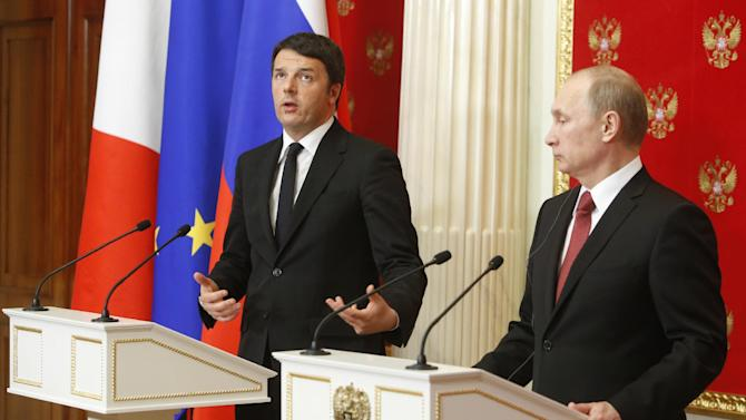 Russian President Vladimir Putin, right, listens to Italian Prime Minister Matteo Renzi during their news conference after the talks in the Kremlin in Moscow, Russia, Thursday, March 5, 2015. Italy's prime minister visited Moscow on Thursday in a bid to repair ties that have been hurt by Russia-West tensions over Ukraine. (AP Photo/Sergei Karpukhin, Pool)