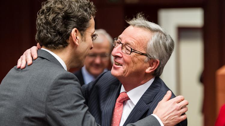 Dutch Finance Minister Jeroen Dijsselbloem, left, greets the President of the Eurogroup Jean-Claude Juncker during an Eurogroup finance ministers meeting at the EU Council in Brussels on Monday, Jan. 21, 2013. (AP Photo/Geert Vanden Wijngaert)