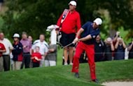 Phil Mickelson of the US swings from the rough off the 3rd fairway during the third preview day of the 39th Ryder Cup at Medinah Country Golf Club in Medinah, Illinois