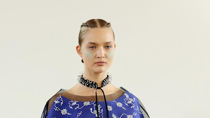 A model on the catwalk during the Huishan Zhang Presentation Spring/Summer 2013 show in the Portico Rooms, Somerset House, London, on the second day of London Fashion Week Saturday Sept. 15, 2012. (AP  Photo/Gareth Fuller/PA) UNITED KINGDOM OUT  NO SALES  NO ARCHIVE
