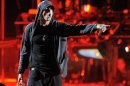 FILE -- In an April 15, 2012 photo Eminem performs onstage at the 2012 Coachella Valley Music and Arts Festival in Indio, Calif. Eminem, who battled an addiction to prescription drugs, thanked his fans at a New York concert Thursday Aug. 9, 2012 for helping him get through dark times.(AP Photo/Chris Pizzello)
